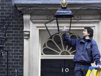 Fitting an energy-saving bulb at No 10